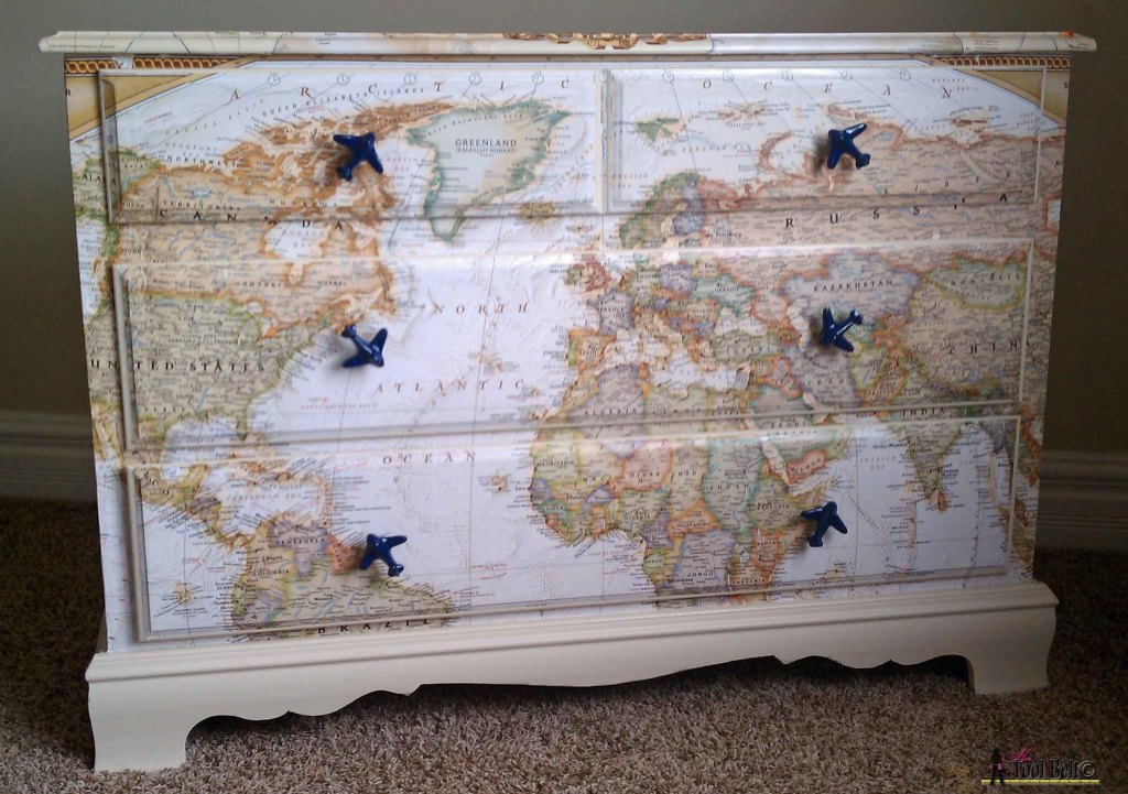 Make over an old dresser into a unique travel theme map dresser with a map and mod podge!