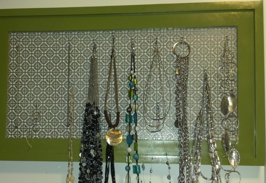 Build a simple stacked wood frame to make a cool jewelry display frame.