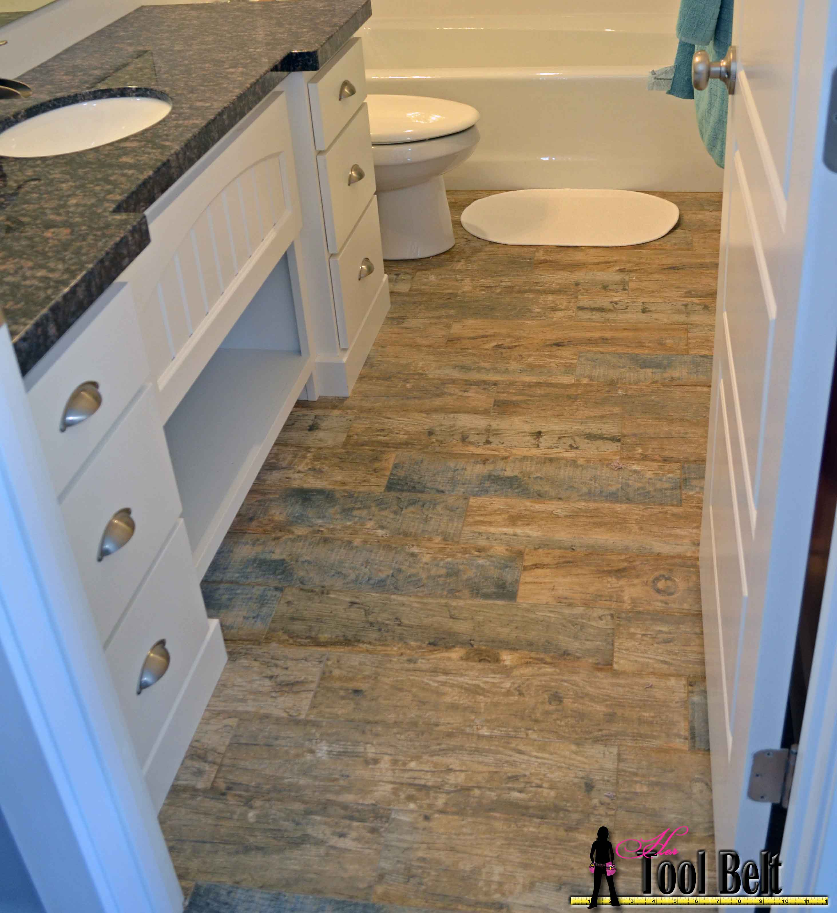 How To Install Wood Tile Barnwood Her Tool Belt - How to replace ceramic tile floor in the bathroom