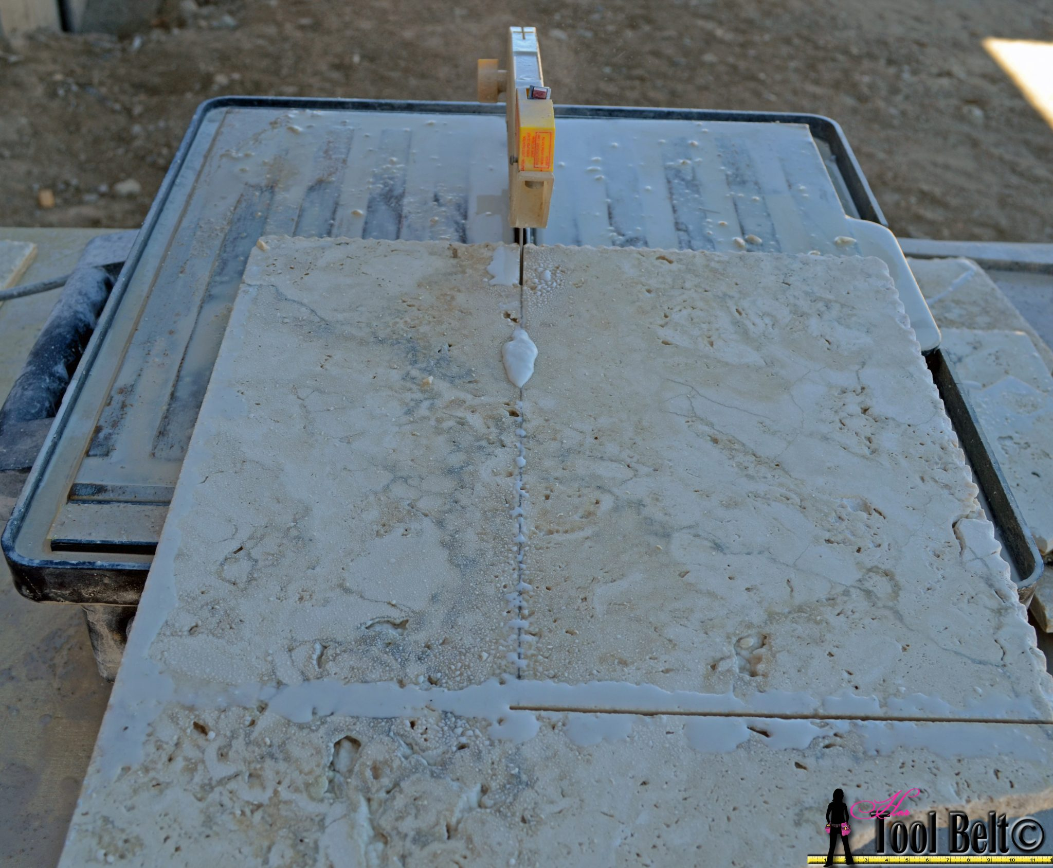 Travertine versailles pattern tile tutorial her tool belt always wear safety glasses when cutting tile measure and mark on the tile with pencil where to make your cut gently feed the tile into the tile saw blade greentooth Images