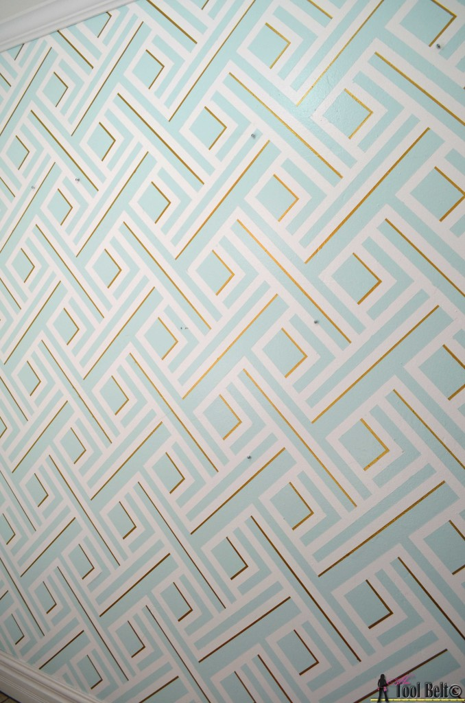 Painting a geometric wall tutorial on hertoolbelt.com  Made with painters tape!