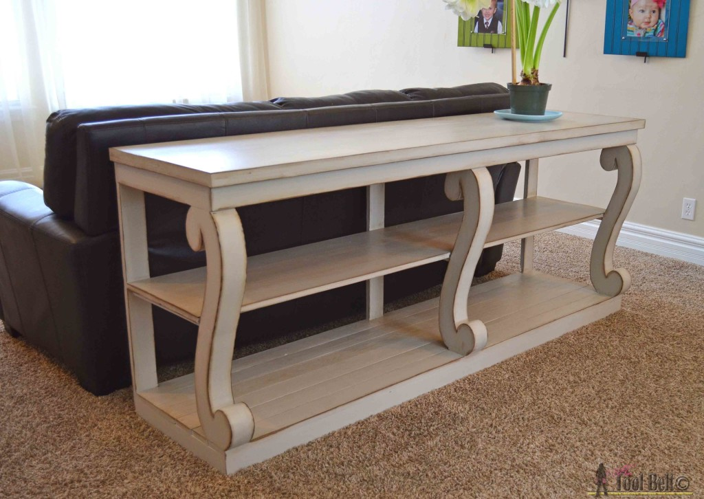 Build a console table with awesome scroll legs, definitely a statement piece! Free woodworking plans.
