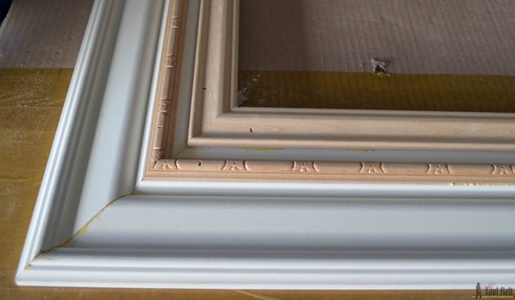 Build a DIY custom picture frame using moulding from the hardware store, so much cheaper than a framing store.