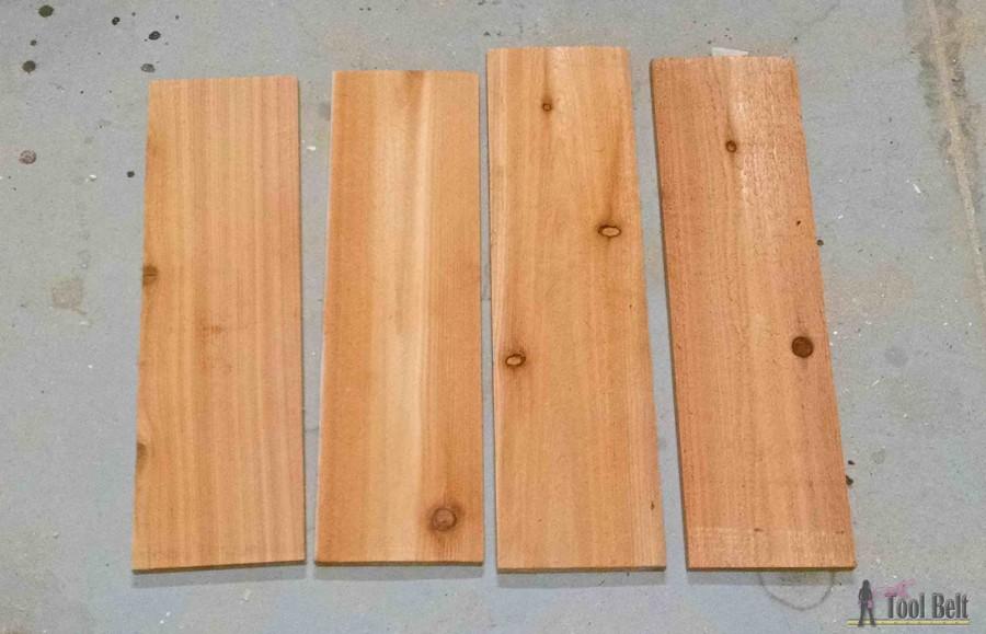 'Let it Snow' - wooden snowflake door hanger tutorial. Made from a super cheap cedar picket $2.45