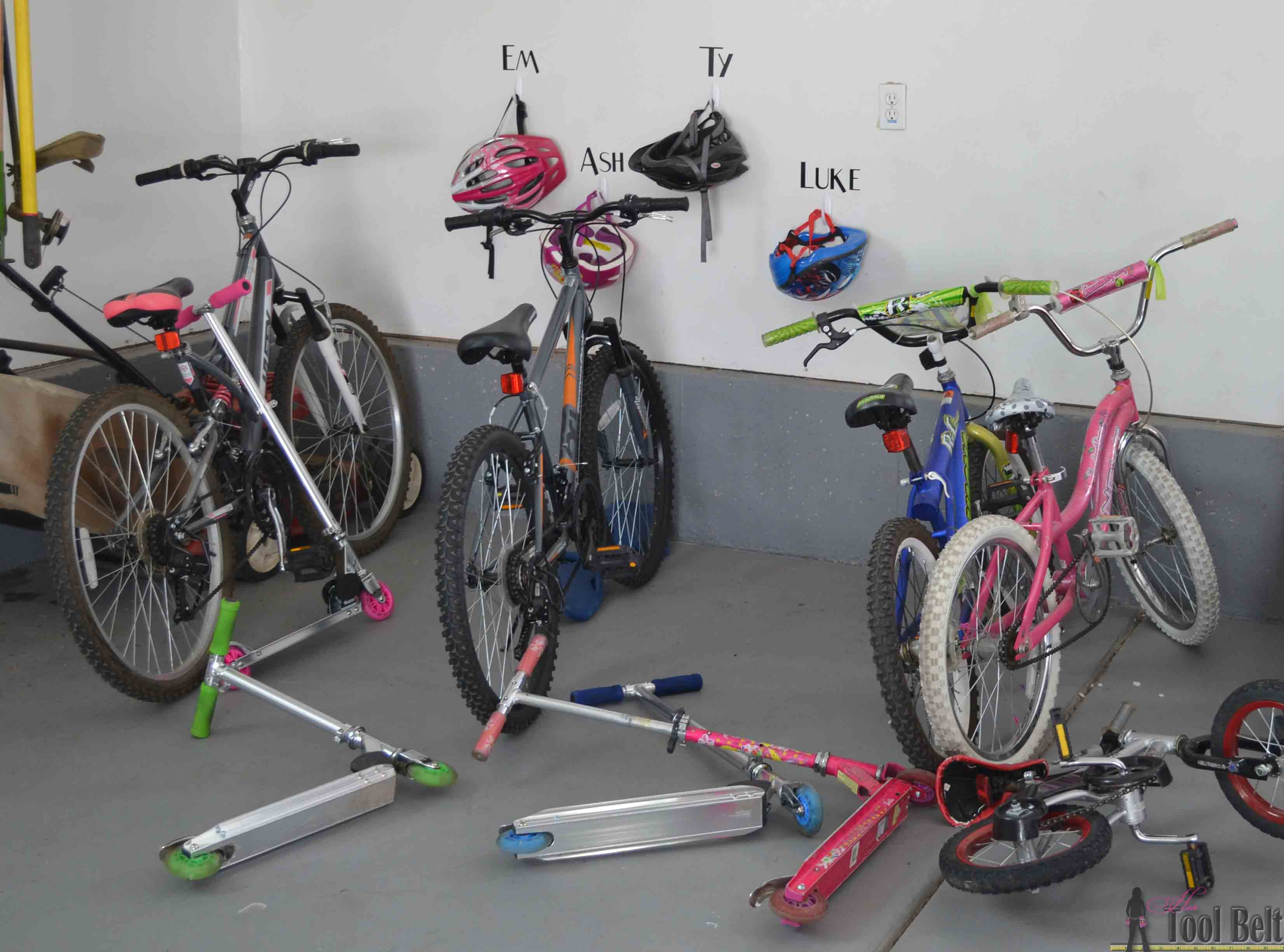Diy bike and scooter rack her tool belt the perfect way to organize those bikes and scooters all over the garage free and solutioingenieria Images
