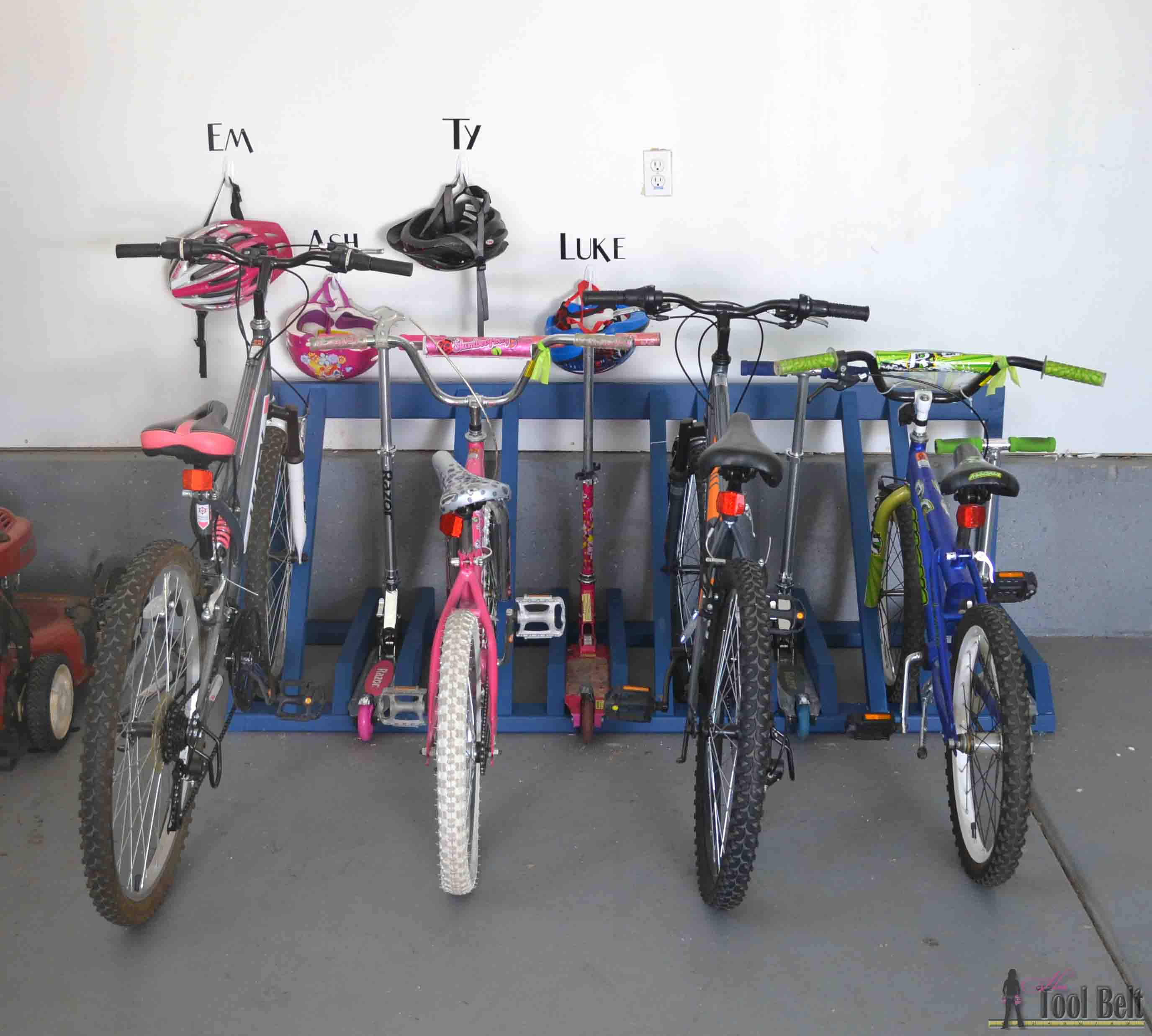 Diy bike and scooter rack her tool belt the perfect way to organize those bikes and scooters all over the garage free and solutioingenieria Image collections