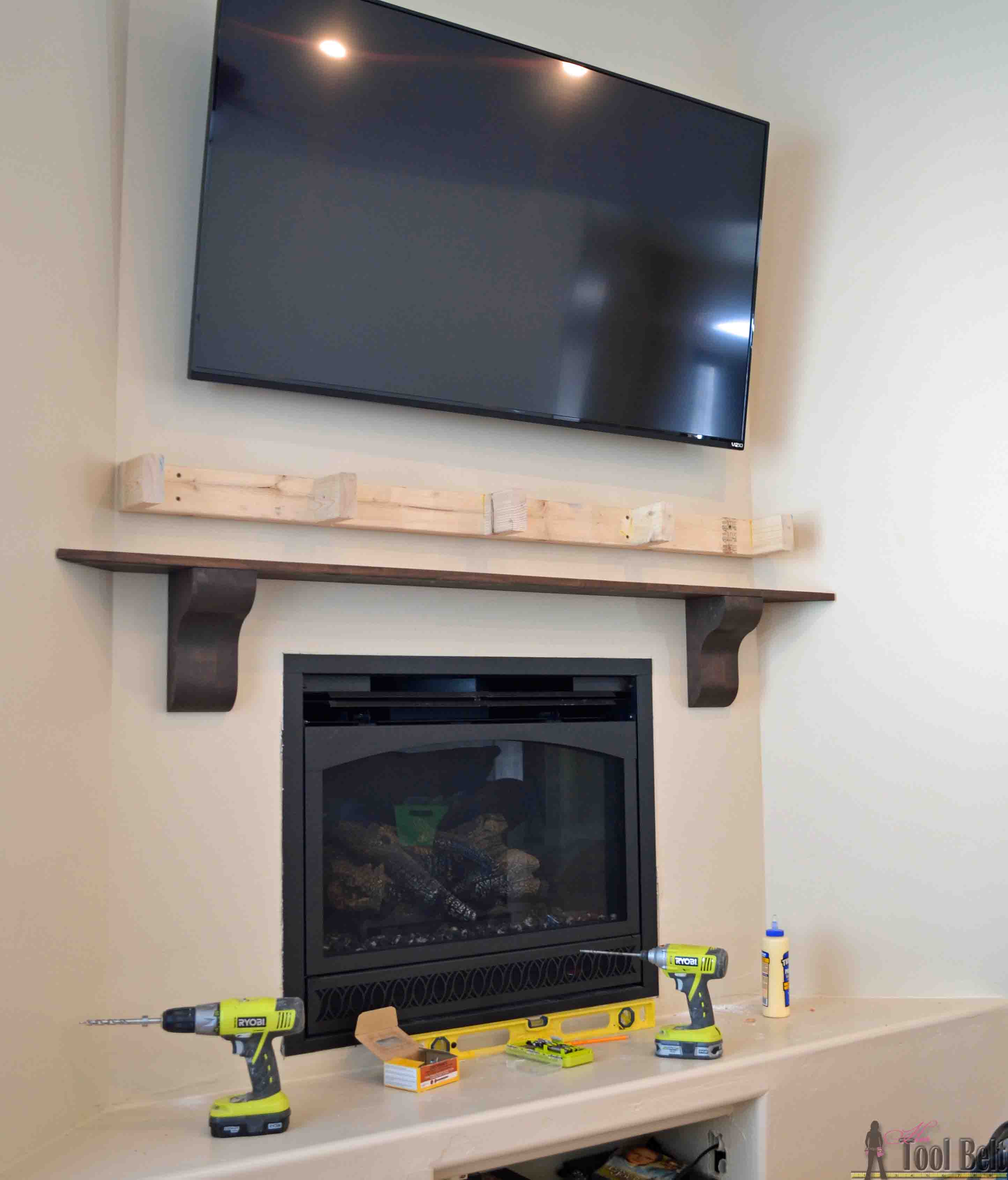 Diy fireplace mantel shelf her tool belt for Building a corner fireplace