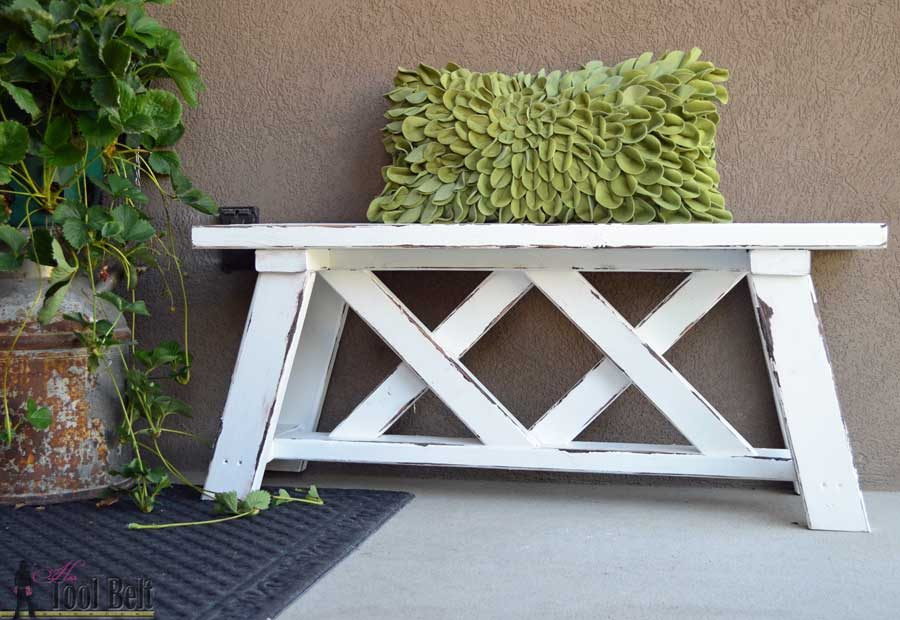 Build a cute little DIY bench for you porch or entry. Use 2x4's to build it for only about $13!!! Free plans