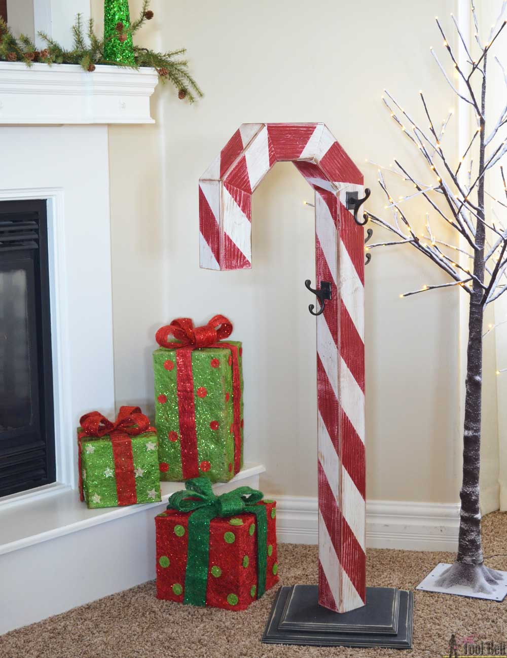 Candy cane holiday stocking post her tool belt for Hanging christmas decorations