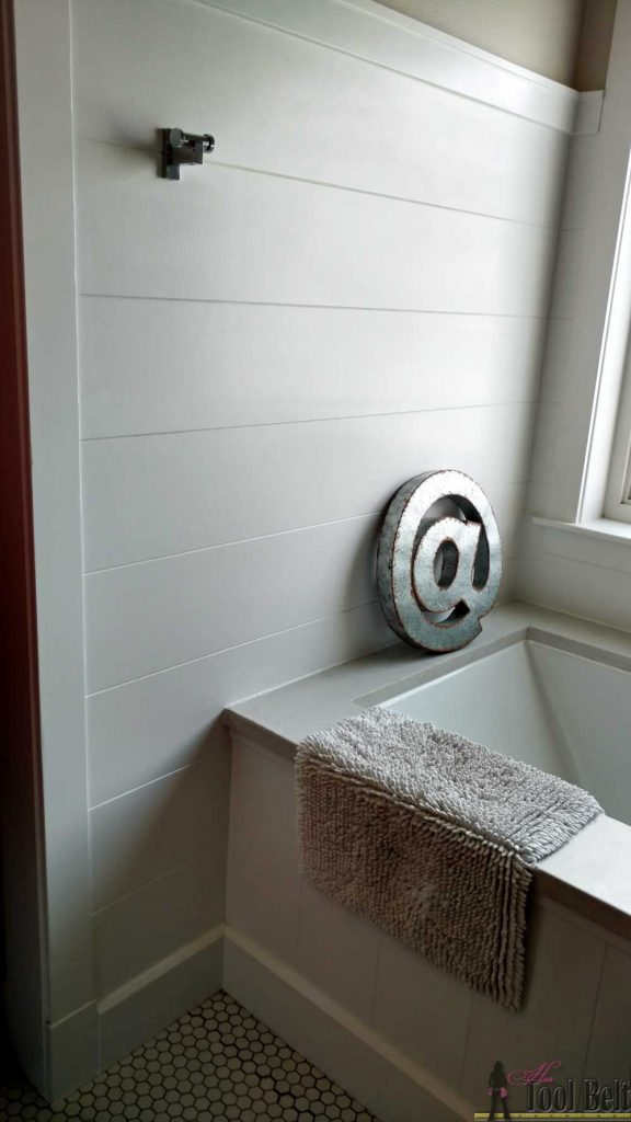 Karilyn's bathroom - faux shiplap wall. Love the look of a shiplap wall but don't want the gaps between the planks. Problem solved, route grooves in a plywood sheet for the shiplap 'planked' wall look! Set by step guide and tips.