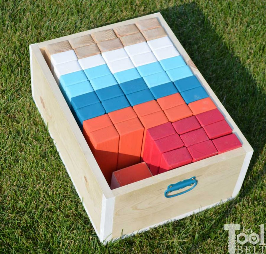 Make your own yard game crate for Giant Block Tower Builder, that doubles as a playing stand. Add colored dice for a fun roll 'n go option to mix things up.