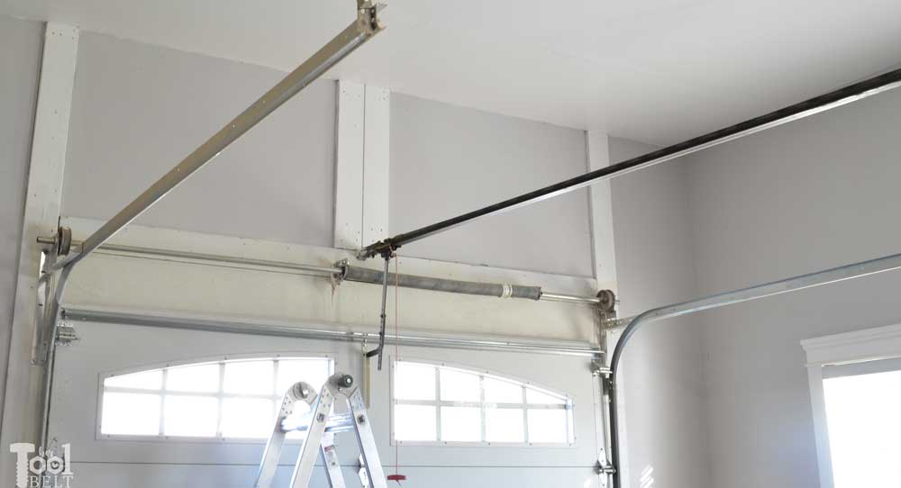 an door take empty overhead build storage belt above shelf that your garage of ceiling mounted tool advantage her space
