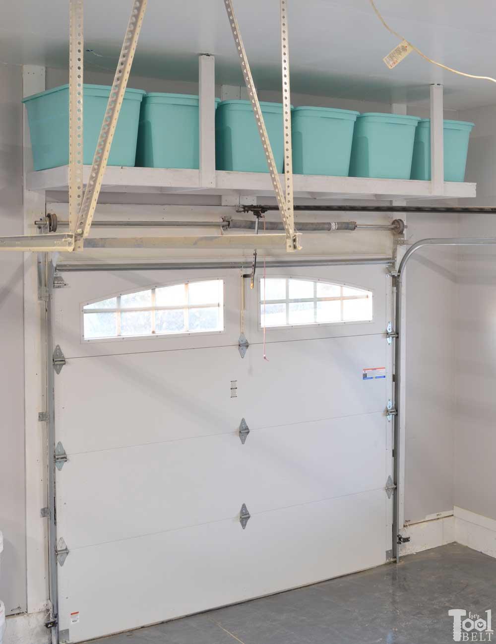 Overhead garage storage shelf her tool belt for Design your garage door