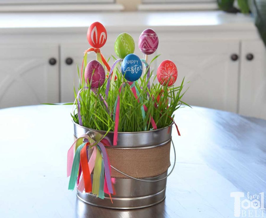 Make a cute and easy Easter centerpiece with engraved eggs. Perfect for spring or Easter egg decor.