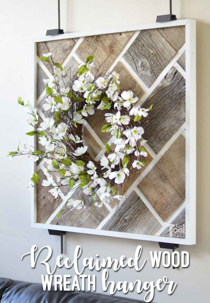DIY Reclaimed wood wall art to hang those beautiful wreaths. Made from barn wood in a fun brick pattern.