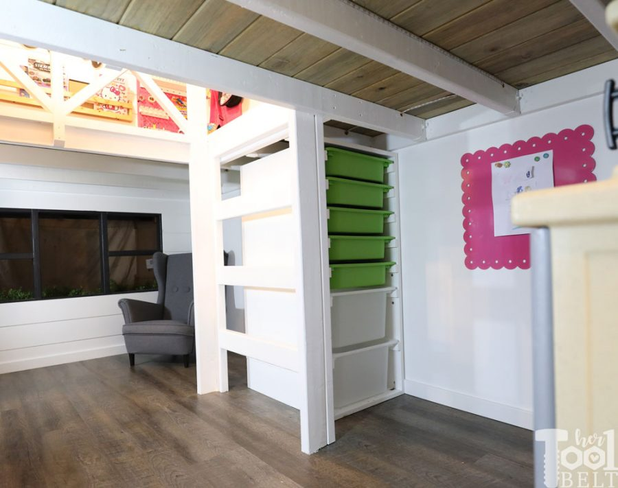 This Mom built a basement playhouse for her kids. It's really a toy room shaped like a modern farmhouse tiny house...come take a tour.