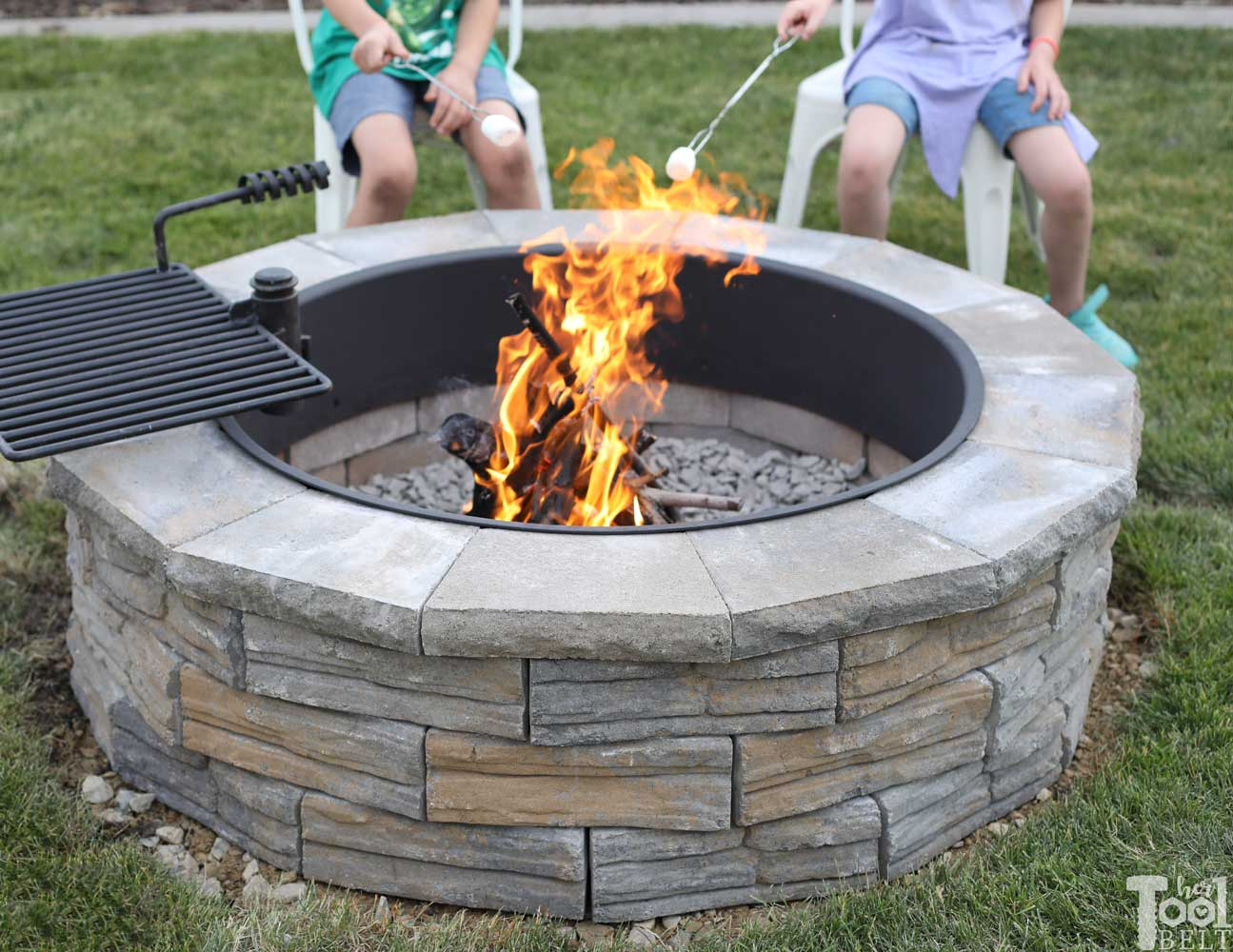 diy-backyard-fire-pit-roasting-marshmallows - Her Tool Belt