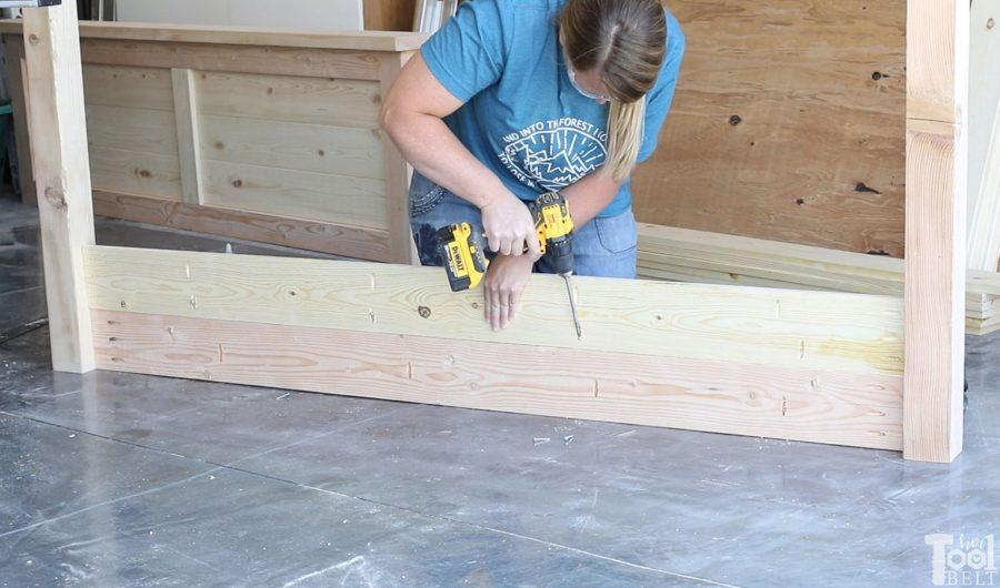 Build a barn door farmhouse bed with X headboard. Free queen size bed building plans on hertoolbelt.com.