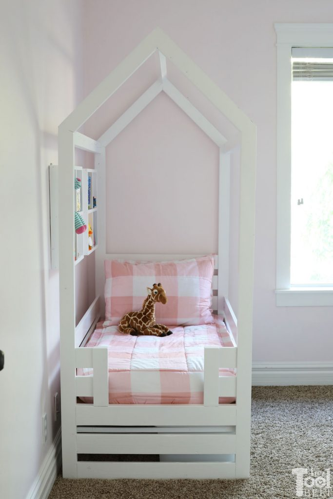 Free plans to build a house frame toddler bed with under the bed storage bins.