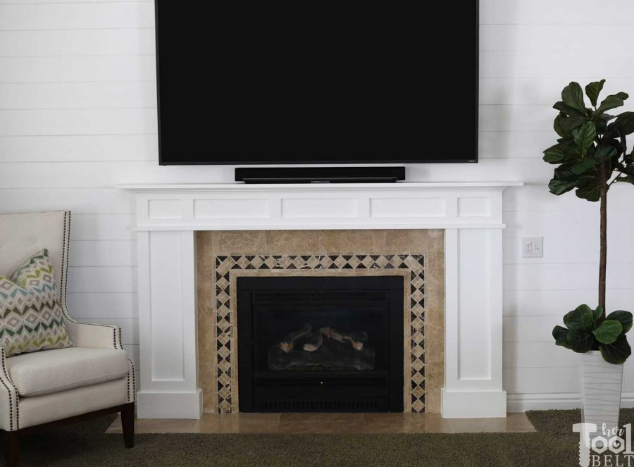 white craftsman mantel and shiplap wall