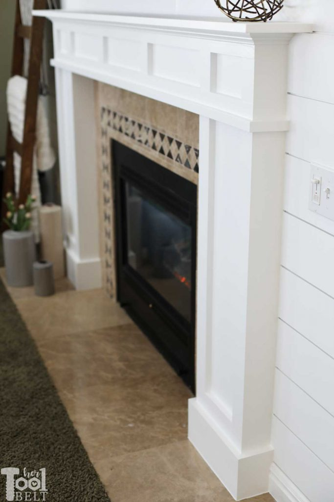DIY modern white craftsman fireplace mantle and shiplap wall.