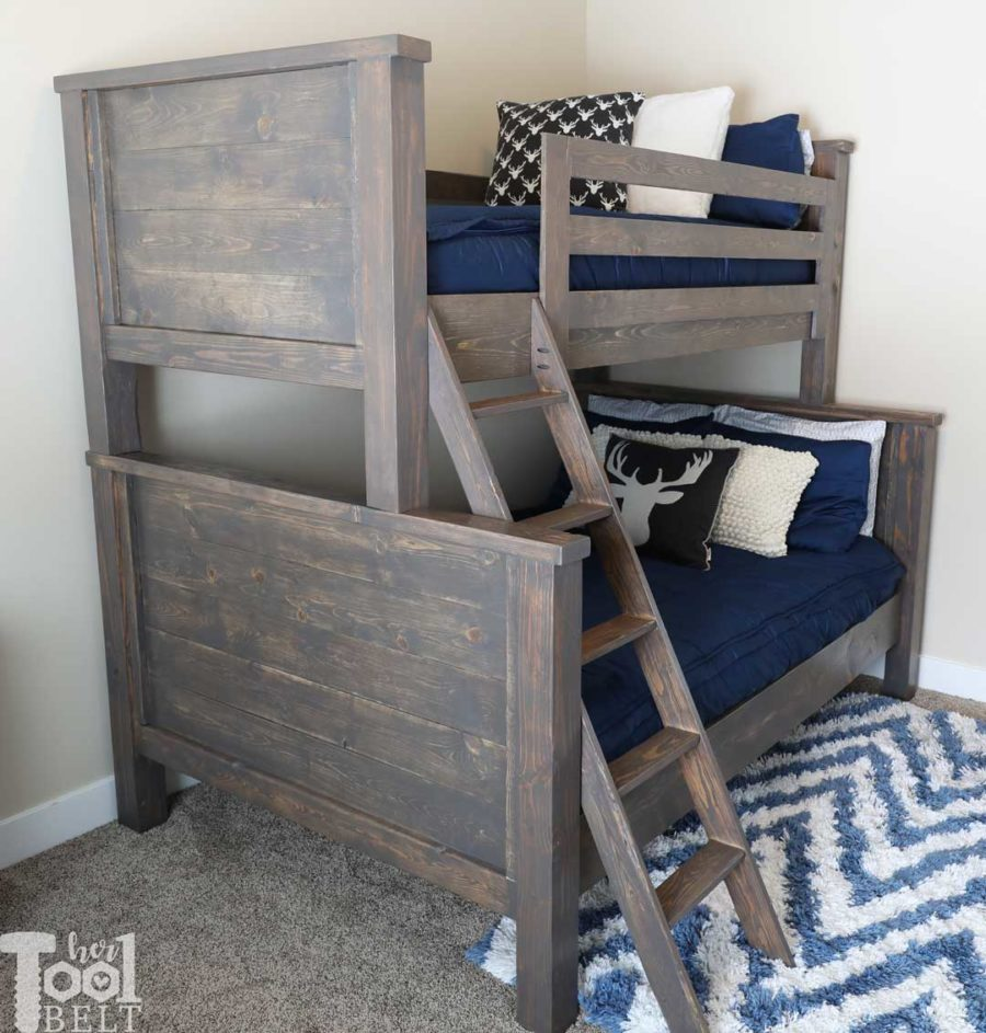 Save space in your kid's bedroom. Free plans to build a farmhouse style twin over full bunk bed. Deer pillows