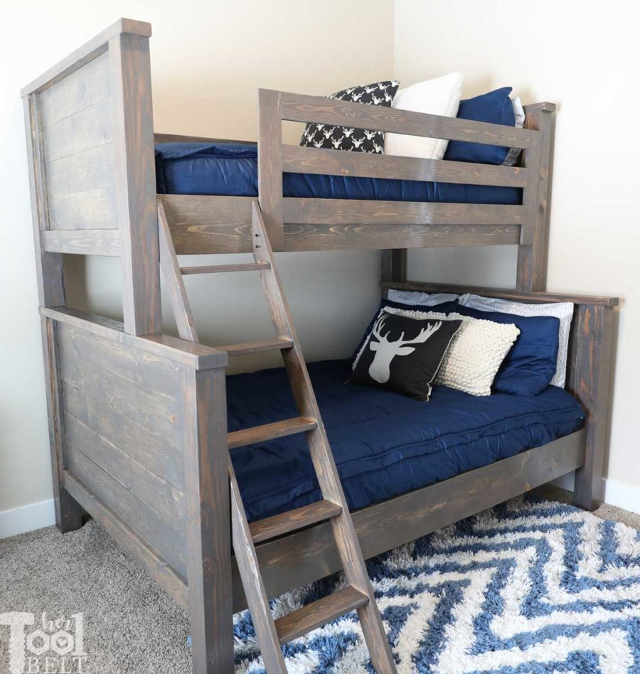 Save space in your kid's bedroom. Free plans to build a farmhouse style twin over full bunk bed. Navy boys room and Deer pillows