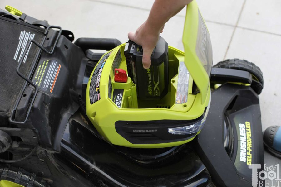 Installing the 40 volt battery in the Ryobi lawn mower. Is a battery powered lawn mower as tough as gas powered? Check out this Ryobi 40 volt lawn mower review.