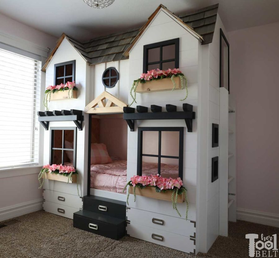 Build a super fun twin bunk bed that looks like a tiny house. Free plans on hertoolbelt.com
