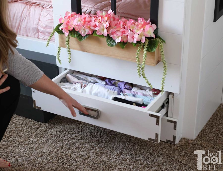 Build a super fun twin bunk bed that looks like a tiny house. Add tons of storage with under the bed drawers. Free plans on hertoolbelt.com