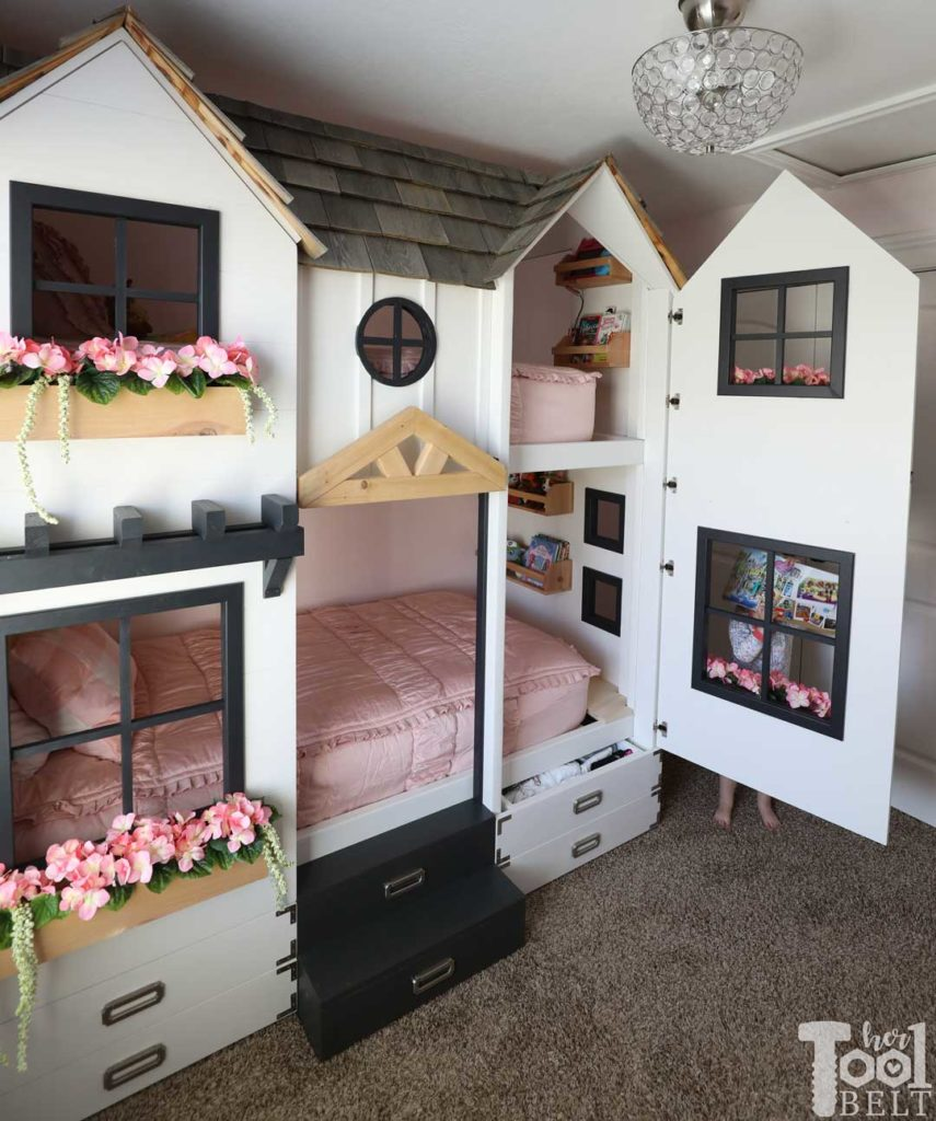Build a super fun twin bunk bed that looks like a tiny house. Easy access to bedding with front panels on hinges. Free plans on hertoolbelt.com