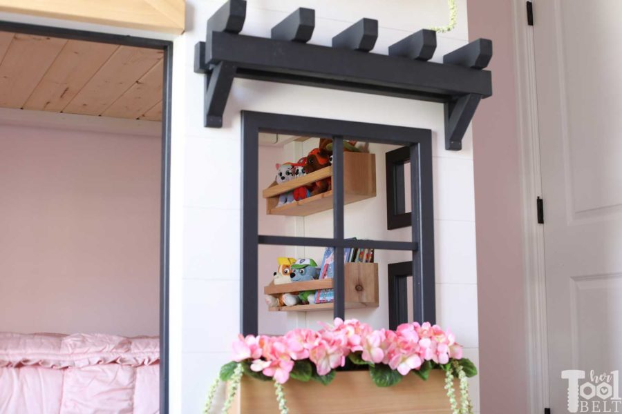 Build a super fun twin bunk bed that looks like a tiny house. Free plans on hertoolbelt.com. Books for story time.