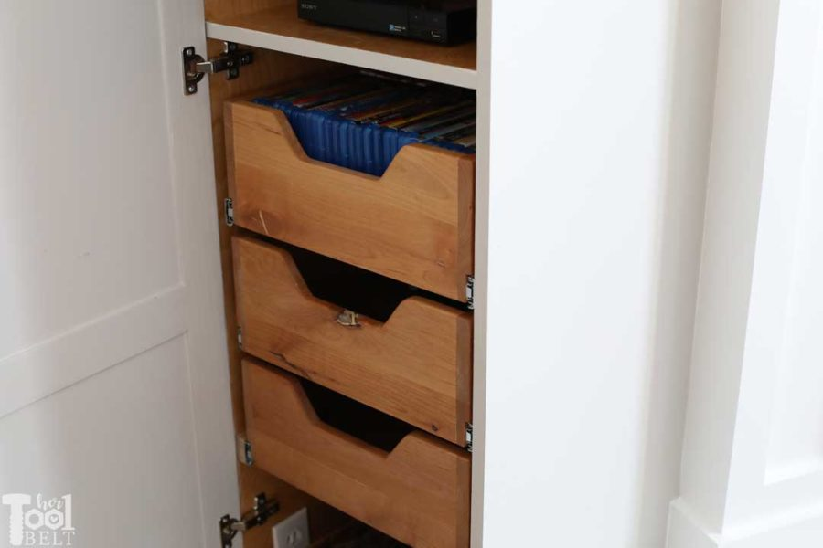 Awesome media cabinet to hold all of the electronics and DVDs for above the fireplace mantel.