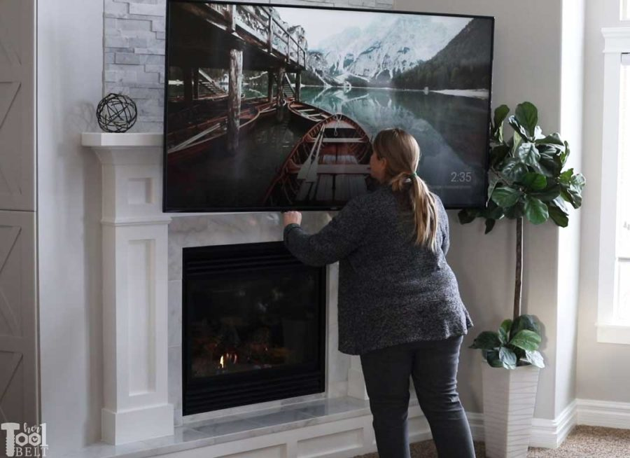 Updating an old builder grade fireplace, into a Modern Farmhouse Mantel. Drop down TV mount for above the fireplace TV's.